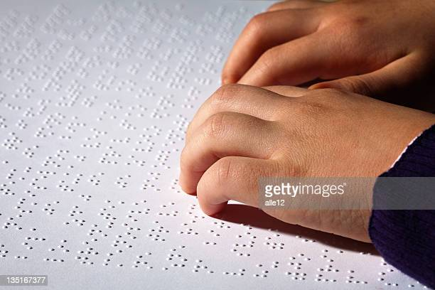 children finger reading braille - braille stock pictures, royalty-free photos & images