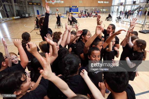 Children finish basketball practice with a team huddle during the launch of the New Zealand Olympic Ambassador Programme at ASB Sports Centre on June...