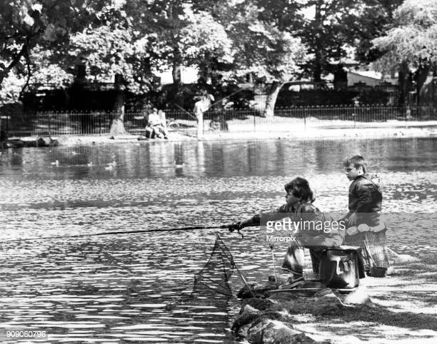 Children fishing in the lake at Albert Park, Middlesbrough, North Yorkshire. Circa 1979.
