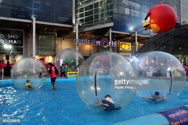 Children floating in giant balloons during National Children's Day at the front of Central World