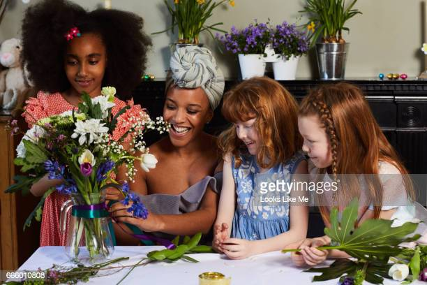 Children flower arranging with their mum and friends.