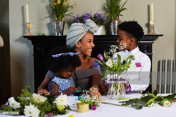 Children flower arranging with their mum.