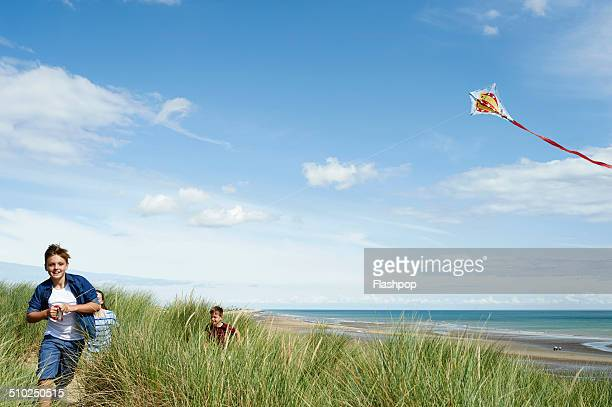 Children flying a kite at the beach