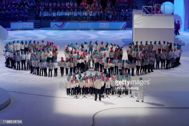 Children form the Olympic rings when a choir sings the Olympic anthem during the Opening Ceremony of the Lausanne 2020 Winter Youth Olympics on...