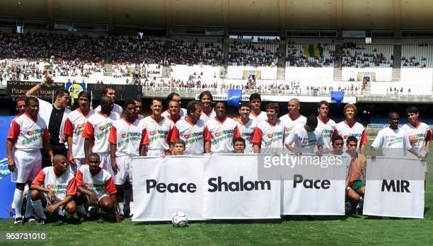 Children form the word Peace in various languages in front of F1 racing pilot Michael Schumacher of Germany Jarno Trulli and Giancarlo Fisichella who...