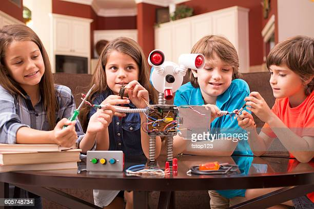 Children friends build robot together at home.
