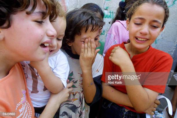 Children friends of eightyearold Aaya Fayaad weep during her funeral August 31 2003 at the Khan Younis refugee camp in the southern Gaza Strip Fayaad...