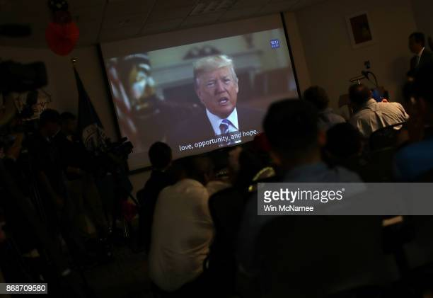 Children from 22 countries watch a video featuring US President Donald Trump congratulating them on their US citizenship after the childen took the...