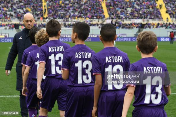 Children from both teams wear football jerseys number 13 to pay tribute to late Fiorentina's captain Davide Astori on March 11 2018 before the...