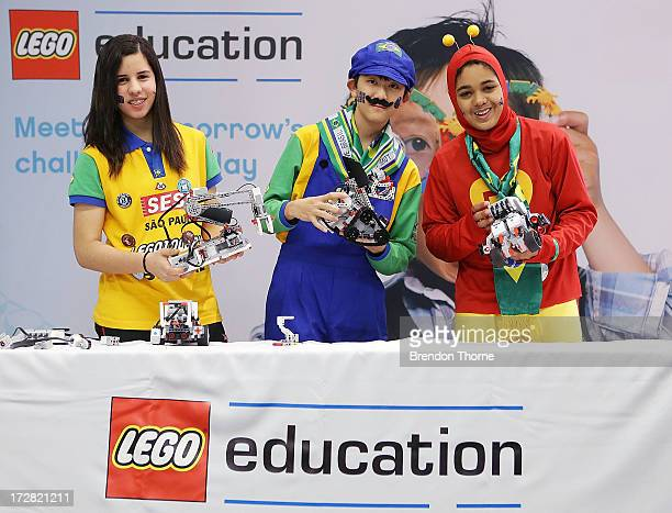 Children from Brazil pose with EV3 robots at the LEGO Education FIRST Robot Games Tournament on July 5 2013 in Sydney Australia Over 50 teams 550...