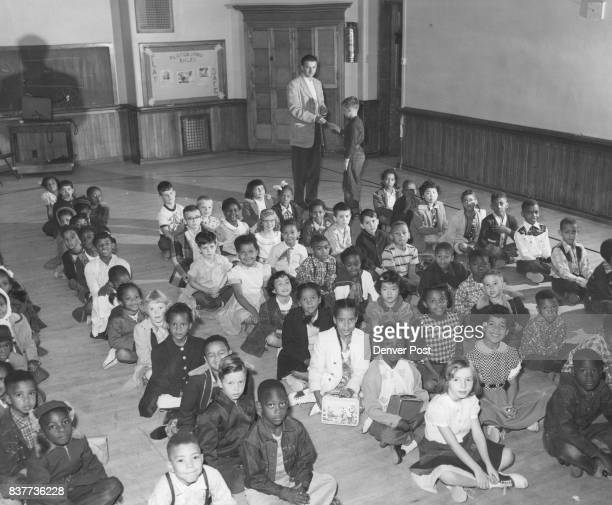 """Children from grade 1 through 3 wait in assembly hall at Columbine elementary school Columbine ft and E"""" 28th Ave for signal to go downstairs to..."""