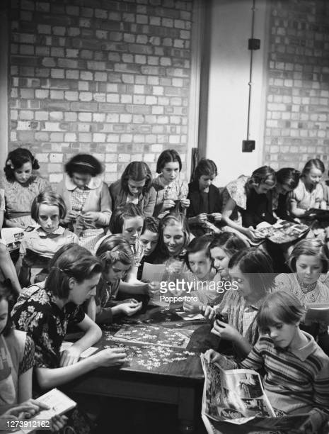 Children from Haverstock Hill Roman Catholic church school in Chalk Farm bring out their knitting and jigsaw puzzles to pass the time in a bomb...
