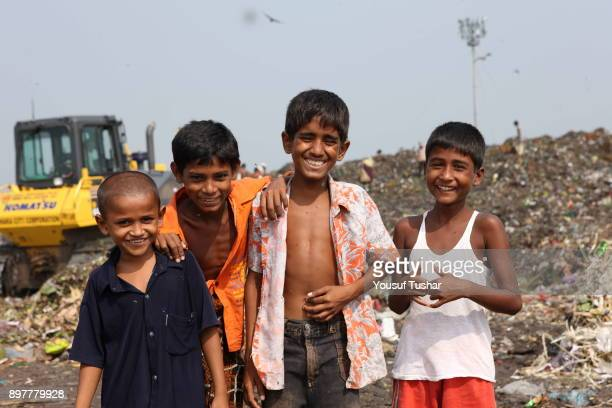 Children from indigent community at garbage pile in Matual dumping yard They collect usable things that are sold to make recycling products Children...