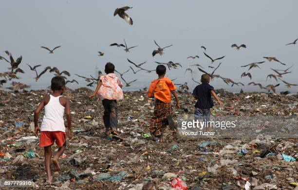 Children from indigent community run at garbage pile in Matual dumping yard They collect usable things that are sold to make recycling products...