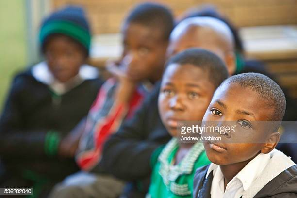 Children from Ithute primary school in the Alexandra Township Johannesburg South Africa watch a performance of the 'About Us' an AREPP Theatre for...