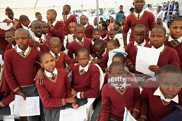 Children from Kanaleno Children's centre for the deaf wait to have hearing aids fitted at Lesotho Cooperative College on October 10 2013 in Maseru...