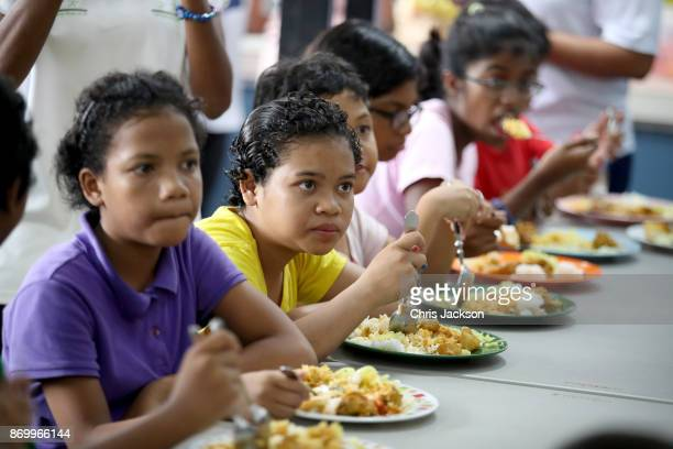 Children from Lighthouse Children's Welfare Centre eat fresh produce as Camilla Duchess of Cornwall visits The Lost Food Project and Lighthouse...