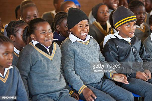 Children from Matsie Steyn primary school Sharpeville Vereeniging South Africa watch a performance of the 'No Monkey Business' puppet show an AREPP...