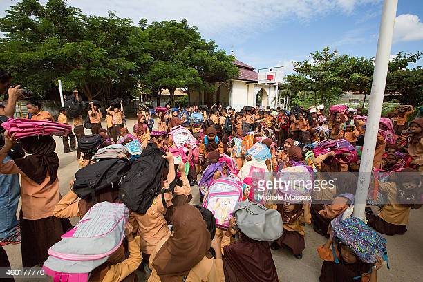 Children from MIN Lhok Nga Elementary School perform a tsunami drill on December 5, 2014 in Banda Aceh, Indonesia. The Indoensian province of Aceh...