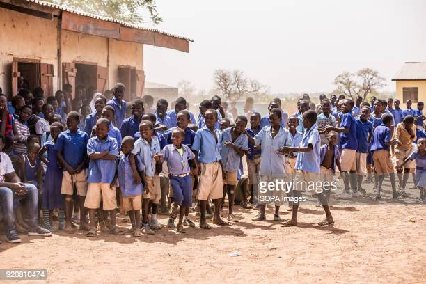 Children from neighbouring schools watch the excitement at TimTooni Football Club, just outside Tamale in Northern Ghana. Along with football coaches...