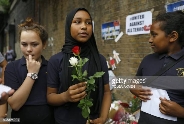 Children from Pakeman Primary School arrive to lay flowers in tribute to the victims of a June 19 van attack in the Finsbury Park area of north...