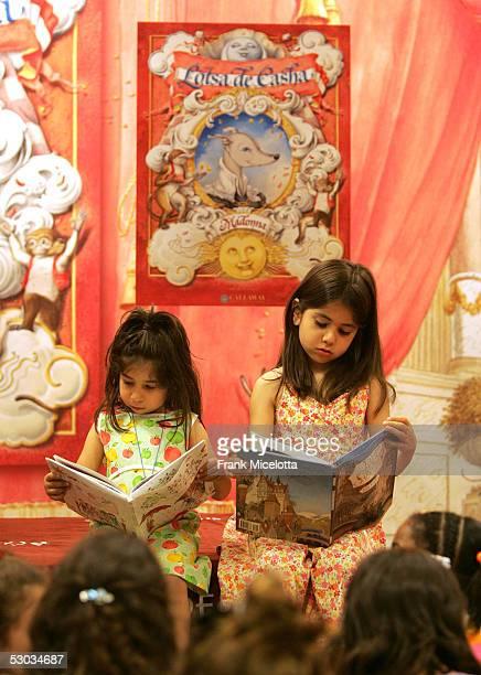 Children from Public School 191 read a copy of singer Madonna's latest children's book 'Lotsa de Casha' at Borders Bookstore June 7 2005 in New York...