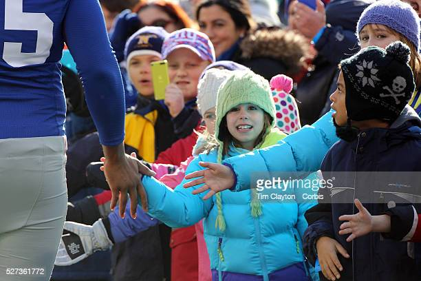 Children from Sandy Hook Elementary School welcome players onto the field as they form a guard of honor for the New York Giants before the start of...