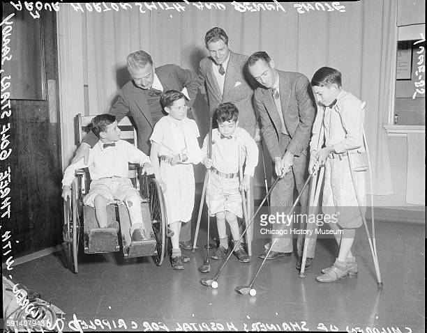 Children from Shriners Hospital for Crippled Children with golfers Sandy Armour Horton Smith and Denny Shute Chicago Illinois June 1935 From the...