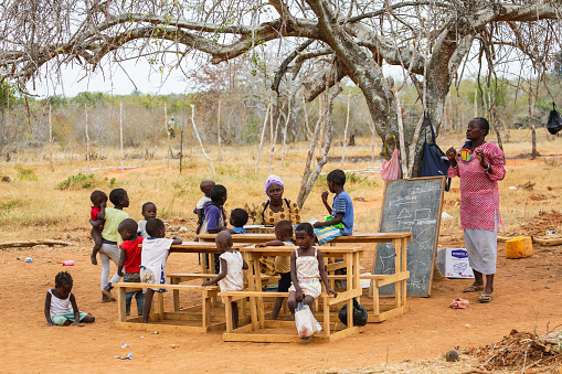 MALINDI, KENYA - JAN 25, 2017: Children from small local village attending open air primary school. 647452298