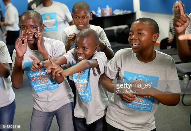 Children from the Basotho Youth Choir made up of six boys and six girls aged between 7 and 19 years old rehearse with Joss Stone at the Brit School...