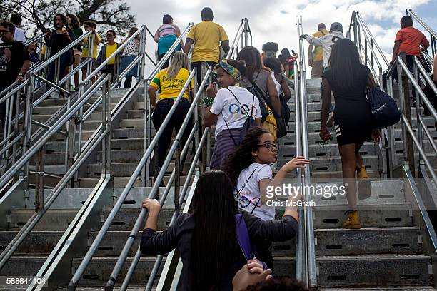 Children from the Cantagalo 'favela' community arrive at the Olympic Rugby 7's venue on August 11 2016 in Rio de Janeiro Brazil A small group of...