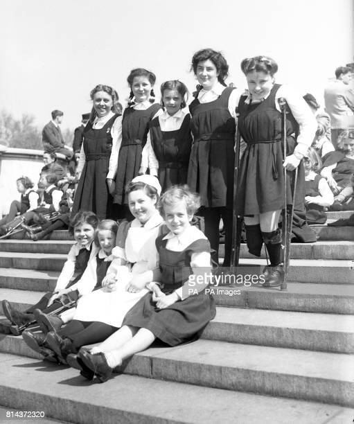 Children from the Halliwick Cripple School Winchmore Hill had a grandstand view of the State Drive from the Victoria Memorial opposite Buckingham...