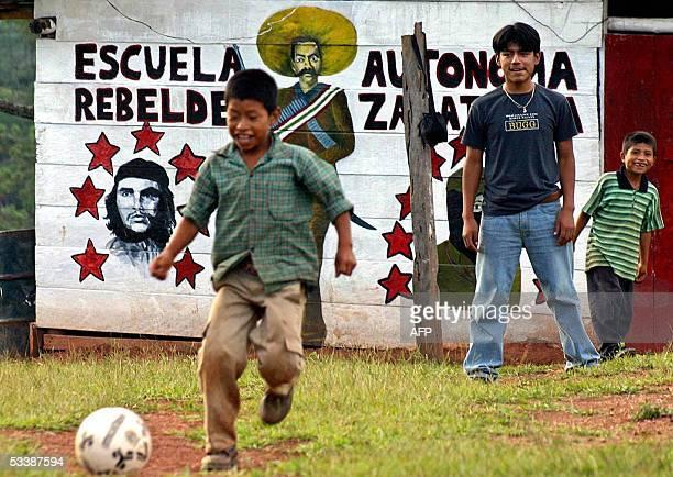 Children from the Javier Hernandez Zapatista village play football near a graffiti with portraits of Ernesto Che Guevara national liberator Emiliano...