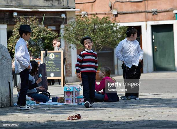 Children from the Jewish community play in the main campo of the Ghetto on November 15 2011 in Venice Italy Established in 1516 the Ghetto of Venice...