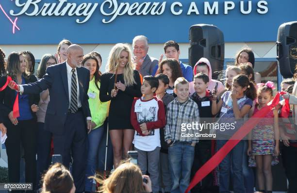 Children from the Nevada Childhood Cancer Foundation surround Nevada Childhood Cancer Foundation President and CEO Jeff Gordon and singer Britney...