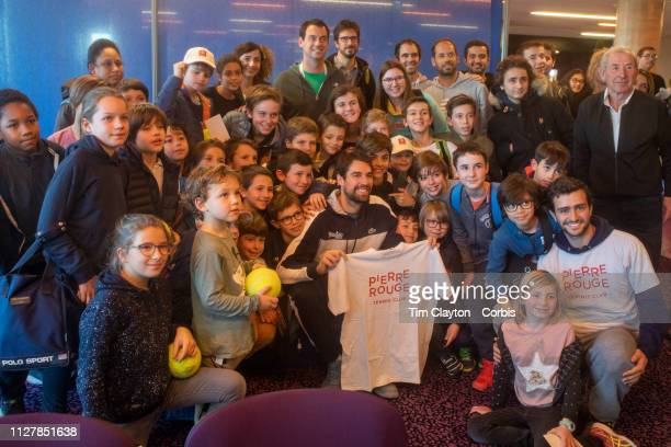 Children from the Pierre Rouge Tennis Club with Jeremy Chardy of France after his win against Antoine Hoang of France during the Open Sud de France...