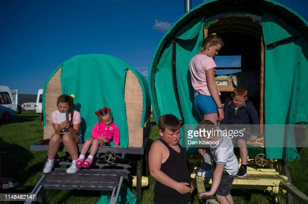 Children from the Price family play outside their Bow Top caravan on the first day of the annual Appleby Horse Fair on June 06 2019 in...