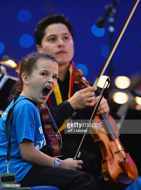 Children from the Raploch estate Big Noise orchestra play at The Big Concert on June 21 2012 in Stirling Scotland The Big Concert is the opening...