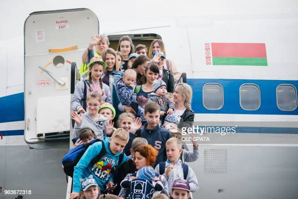 Children from the region around Chernobyl in the Ukraine leave a plane after arriving at the airport in Hanover central Germany on May 30 2018 The...