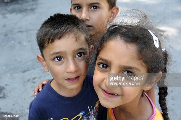 Children from the Roma community are pictured in a camp of caravans called 'Area16' on August 27 2012 in Strasbourg eastern France The 'Area 16' in...