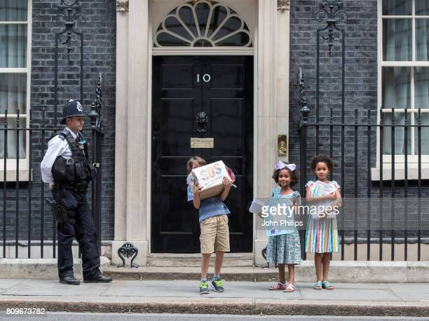 Children from the Save Our Schools campaign Jonny Millercole aged 7 and Suzie and Leone Ali aged 8 deliver hand written letters to Downing Street...