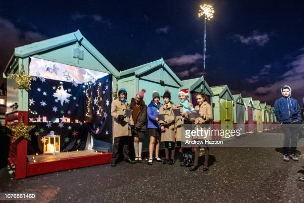 Children from Windlesham School in Brighton singing carols at the 10th annual Beach Hut Advent Calendar on the city's seafront. Each evening, between...