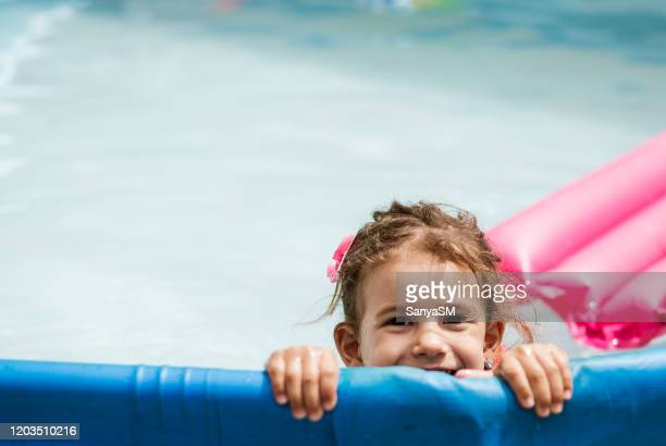 children games in swimming pool - kids pool games stock pictures, royalty-free photos & images