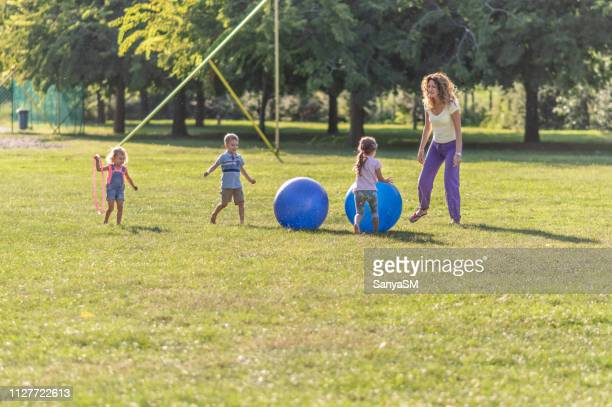children games with a ball - hot teacher stock pictures, royalty-free photos & images