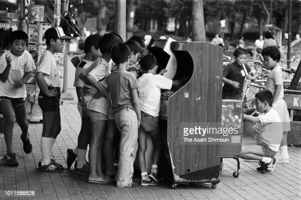 Children gather at video games on September 17, 1985 in Tokyo, Japan.