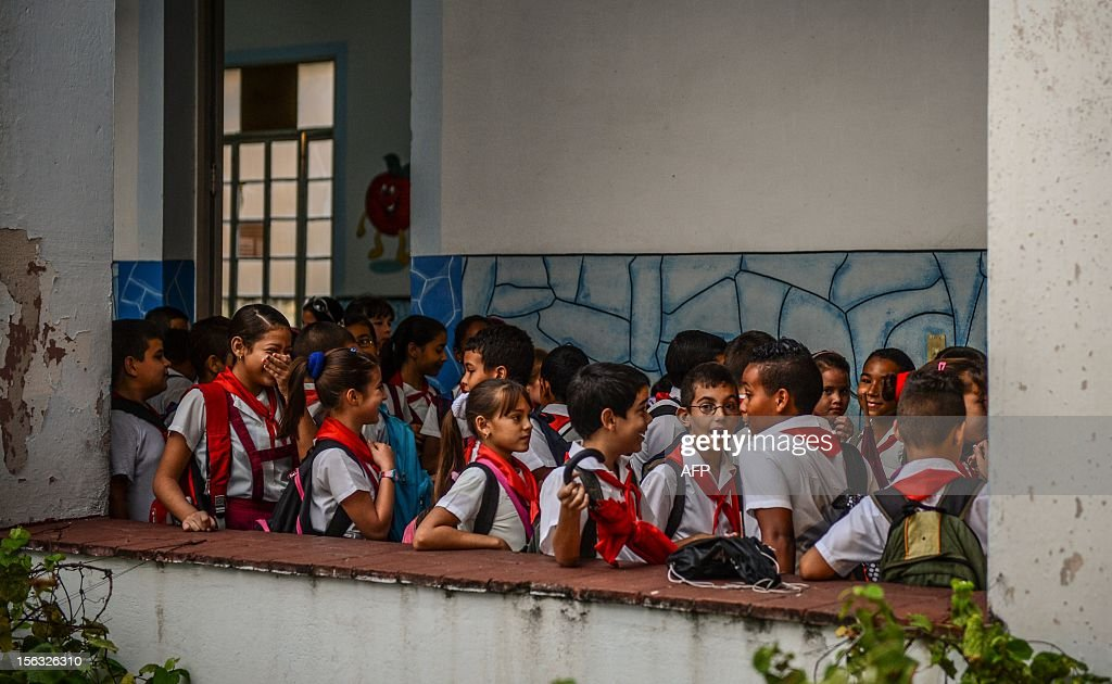 Children gather before getting into their classrooms at a school in Havana on November 13, 2012.