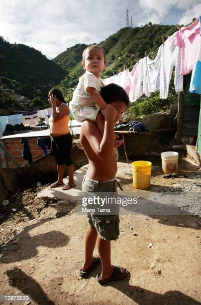 Children gather in the poor barrio of Coche November 29 2006 in Caracas Venezuela Despite daily problems with fresh water and electricity residents...