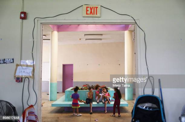 Children gather on Christmas day in the shelter for Hurricane Maria victims where they currently reside on December 25 2017 in Toa Baja Puerto Rico...