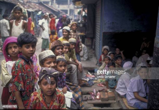 Children gather outdoors for class in the area known as The City of Joy in Kolkata, India. This very poor area was under renovation, including...