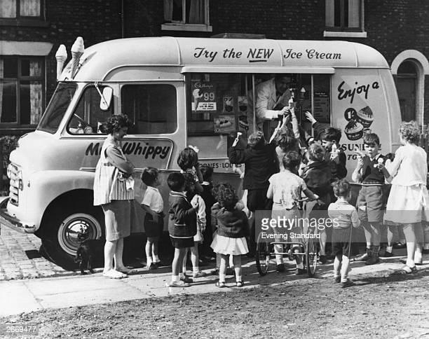 Children gather round a Mr Whippy ice cream van